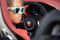Chloe Chambers driving Porsche 718 Spyder for Guinness World Record in slalom